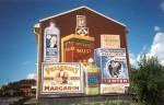 """""""Vid affären"""", Vedum, 6,5 m X 7 m, fasadmålning, Keim silikatfärg Kund: Vara kommun, 2001"""